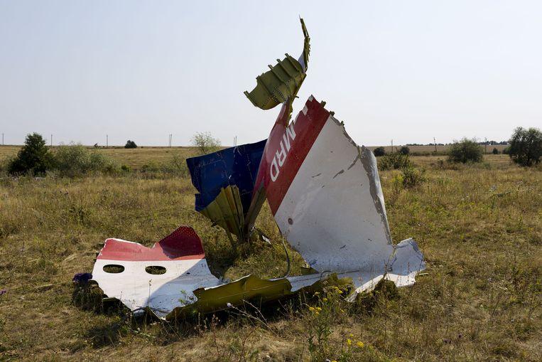 Restanten van de Malaysia Airlines Boeing in het rampgebied, drie weken na de crash van vlucht MH17. Beeld anp