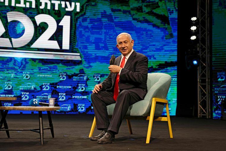 Benjamin Netanyahu afgelopen week tijdens een tv-interview in Jeruzalem. Beeld AFP