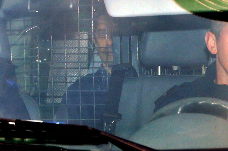 Lelièvre tijdens zijn vervoer naar de rechtbank. Beeld Photo News