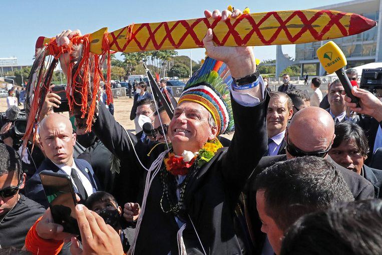 President Jair Bolsonaro te midden van aanhangers, 12 augustus 2021. Beeld Isac Nobrega / AFP