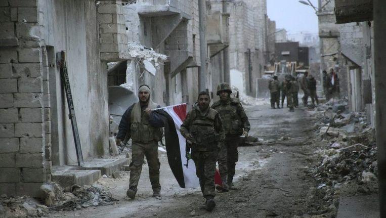 Syrische soldaten die vechten voor president Bashar Assad. Beeld reuters