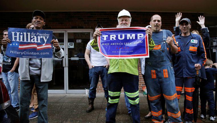 Aanhangers van Hillary Clinton en van Donald Trump op een campagnebijeenkomst in West Virginia.