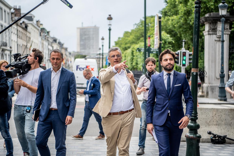 De voorzitters Egbert Lachaert (Open Vld), Joachim Coens (CD&V) en Georges-Louis Bouchez (MR) bewandelen toch weer het paars-gele spoor.    Beeld Photo News
