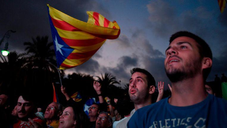 Catalaanse demonstranten dinsdag in Barcelona. Beeld afp