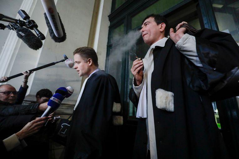 Advocaten Henri Laquay en Sebastien Courtoy staan de pers te woord bij de voorbereidende zitting.  Beeld BELGA