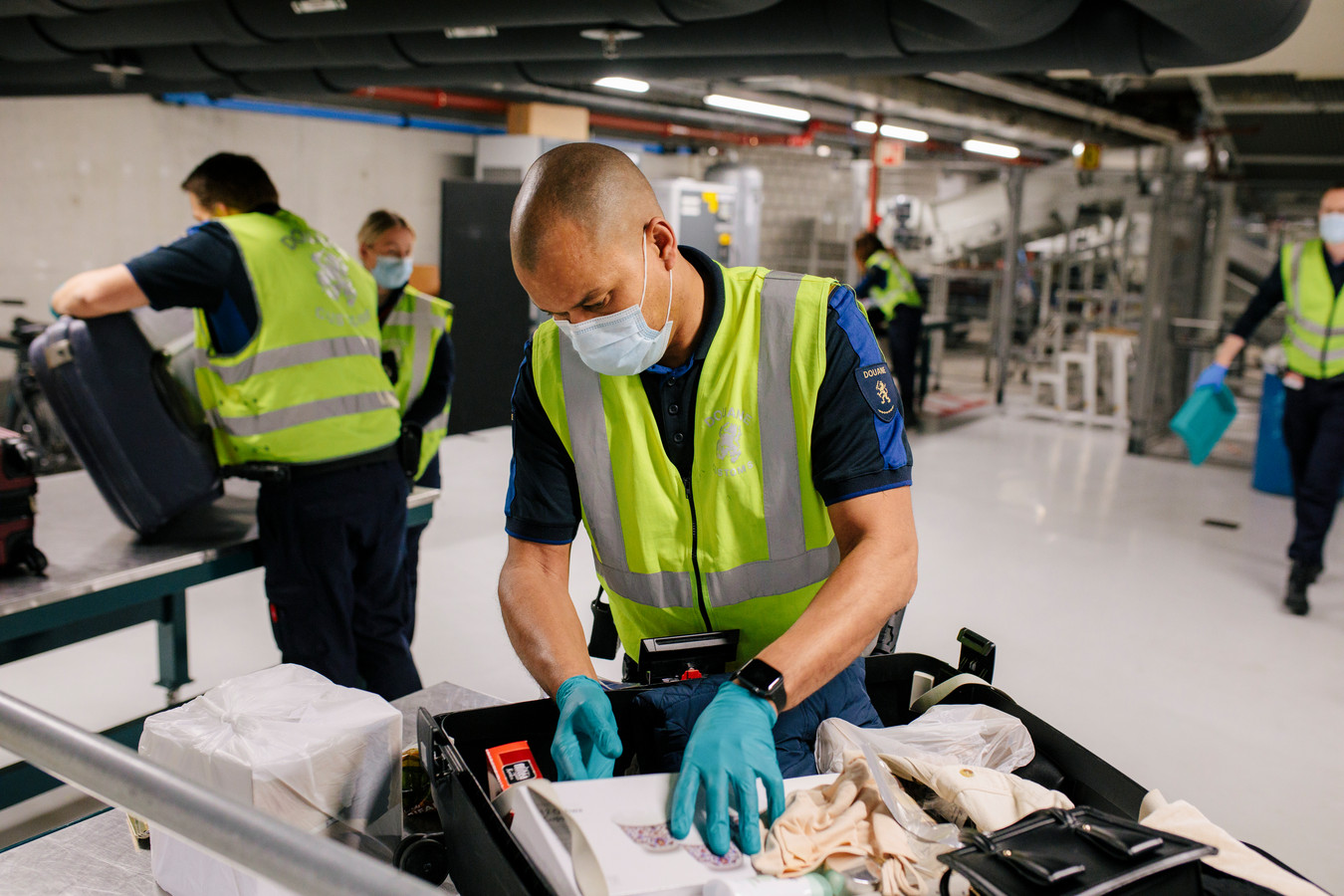 De douane bagage-afhandeling op Schiphol.