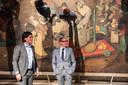 """Vlaams minister van toerisme Ben Weyts en de Limburgse gedeputeerde van toerisme Igor Philtjens bij het schilderij """"De strijd tussen carnaval en de vasten"""" van de Vlaamse meester Pieter Breugel de Oude. Bokrijk laat Breugel, z'n tijd en voorwerpen uit de dagelijks leven herleven in """"De wereld van Bruegel"""" in Bokrijk."""