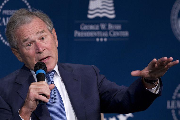 Voormalig president George W. Bush sleepte de Amerikanen in een langdurig conflict in Irak. Beeld AP