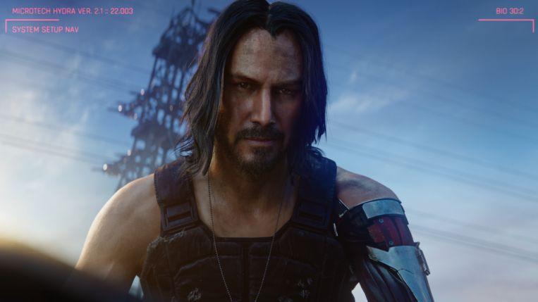 Keanu Reeves als personage Johnny Silverhand (zie die indrukwekkende armprothese) in 'Cyberpunk 2077'. Beeld CD Projekt Red