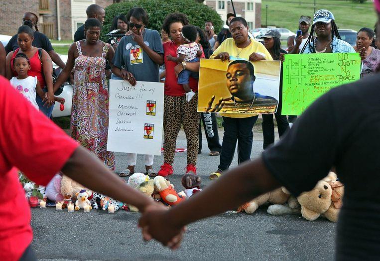 Een wake ter nagedachtenis van de doodgeschoten Mike Brown inFerguson, Missouri. Beeld Photo News