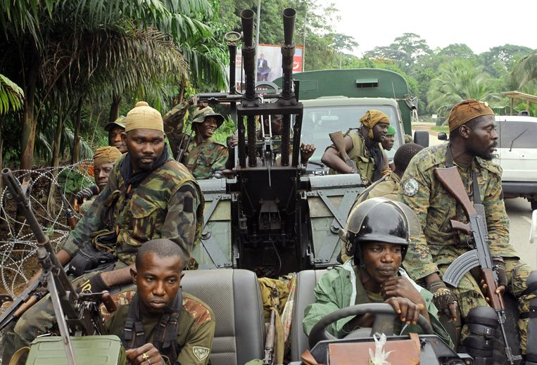 Internationally recognised leader Alassane Ouattara's FRCI (Republican Forces of Côte d'Ivoire) soldiers ride an armed vehicle as they prepare for the so-called ''final assault'' in front of the Golf hotel in Abidjan, on April 5, 2011. The army chief of staff loyal to Ivory Coast strongman Laurent Gbagbo told AFP today that his troops had stopped fighting against rival Alassane Ouattara's forces. Ouattara's forces launched what they called a