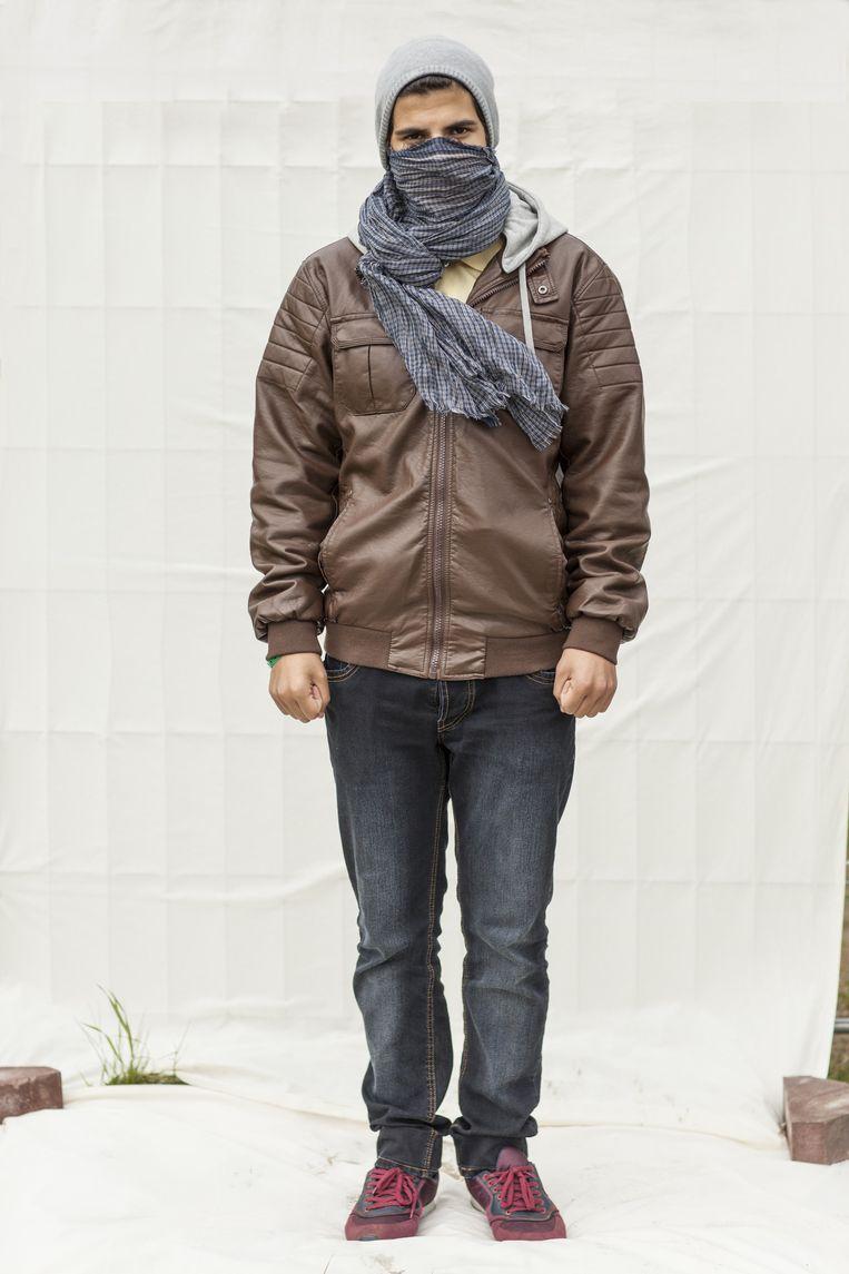 Mohammed (19) uit Homs. Wil niet vechten voor Assad. 'Een leider moet het verdienen om voor te vechten. Deze heeft mijn huis gebombardeerd.' Wil net als zijn vader advocaat worden. Beeld Harry Cock/de Volkskrant