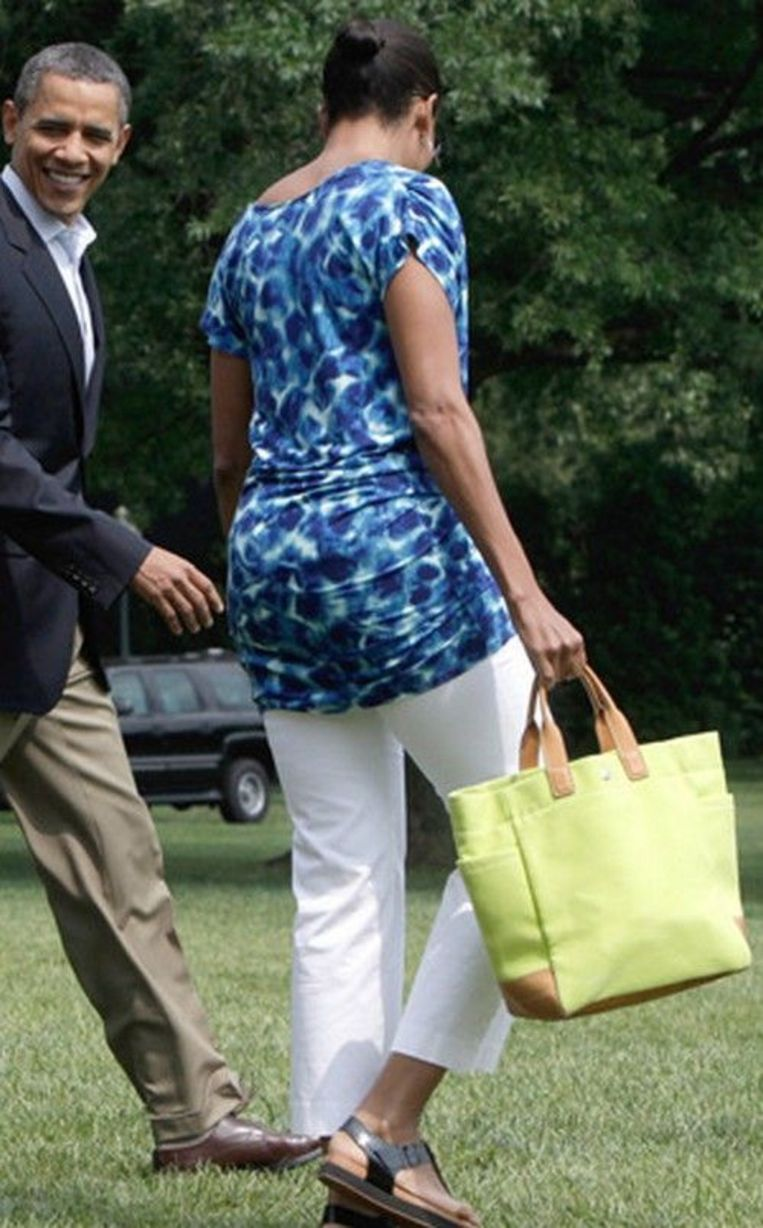 Michelle Obama in een outfit van GAP. De tuniek kostte 29,99 dollar.  Beeld rv
