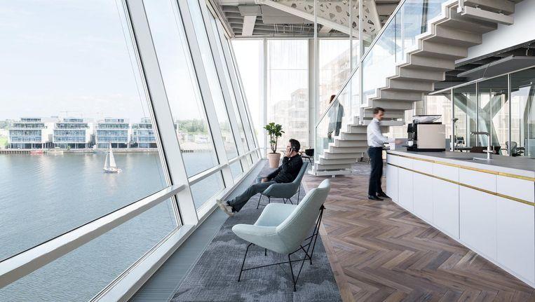 Het interieur van het hoofdkantoor van Amvest is ontworpen door Firm Architects. Beeld Studio de Nooyer