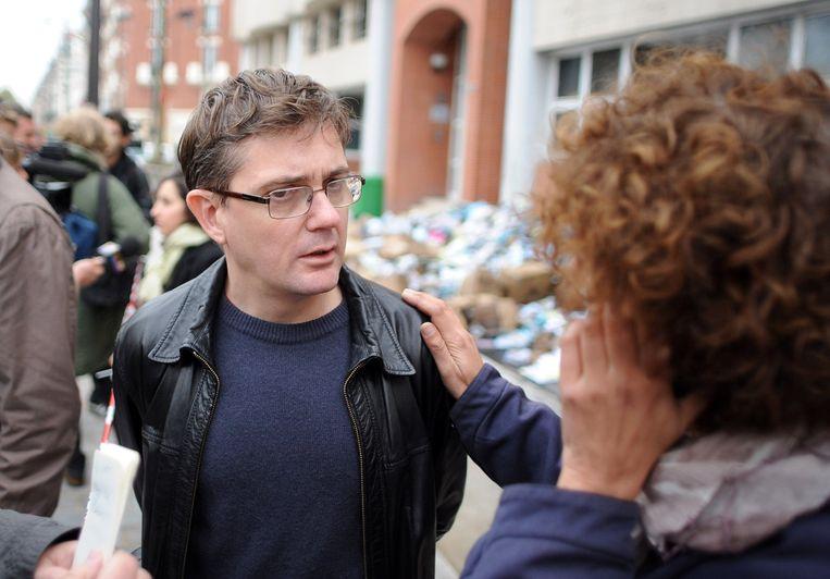Stéphane Charbonnier na de aanslag met een brandbom op de kantoren van Charlie Hebdo in november 2011. Beeld PHOTO_NEWS