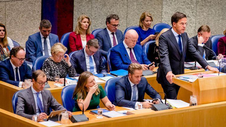 Premier Mark Rutte en de bewindslieden van het kabinet Rutte III tijdens een plenair debat in de Tweede Kamer over de regeringsverklaring. Beeld anp