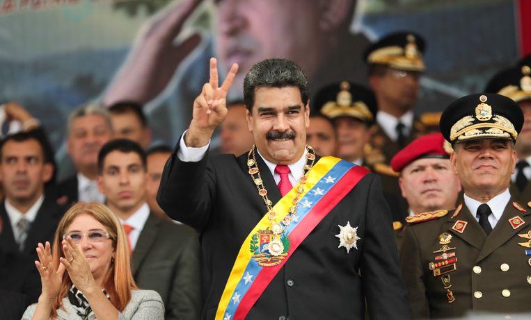 President Maduro vorig jaar juni tijdens een militaire parade in Valencia.  Beeld EPA