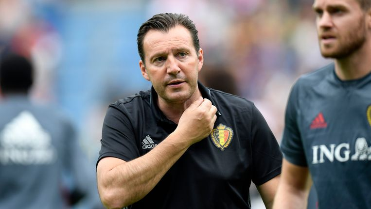 Bondscoach Marc Wilmots en Nicolas Lombaerts. Beeld Photo News