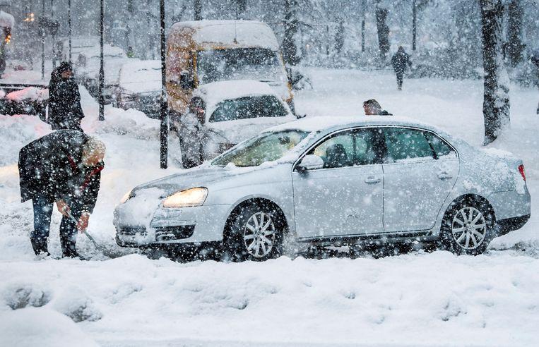 Verkeerschaos in Stockholm na een zware sneeuwstorm, vorige week. Beeld REUTERS