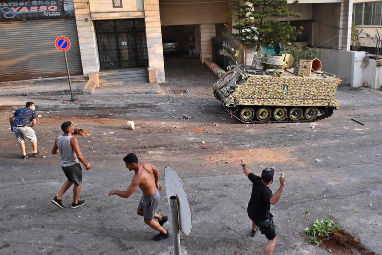 Aanhangers van Hariri gingen donderdag de straat op in Beiroet. Beeld AFP