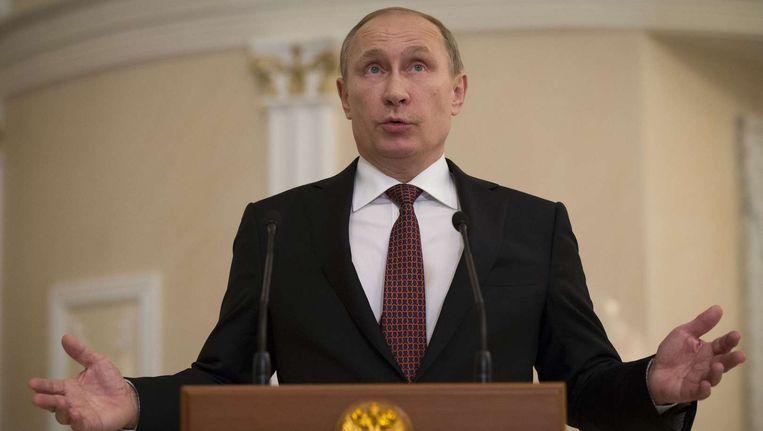 De Russische president Poetin na afloop van de gesprekken. Beeld AFP