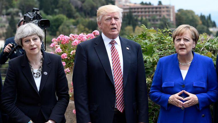 Britse premier Theresa May, Amerikaanse president Donald Trump and Duitse bondskanselier Angela Merkel bij de G7-top in het Italiaanse Taormina. Beeld afp