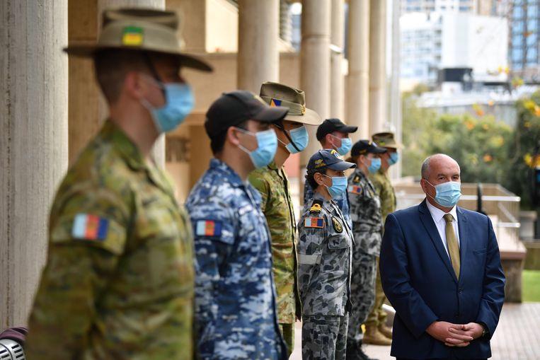 Australische militairen gisteren bij de aankondiging van de nieuwe maatregelen in Sydney. Beeld EPA