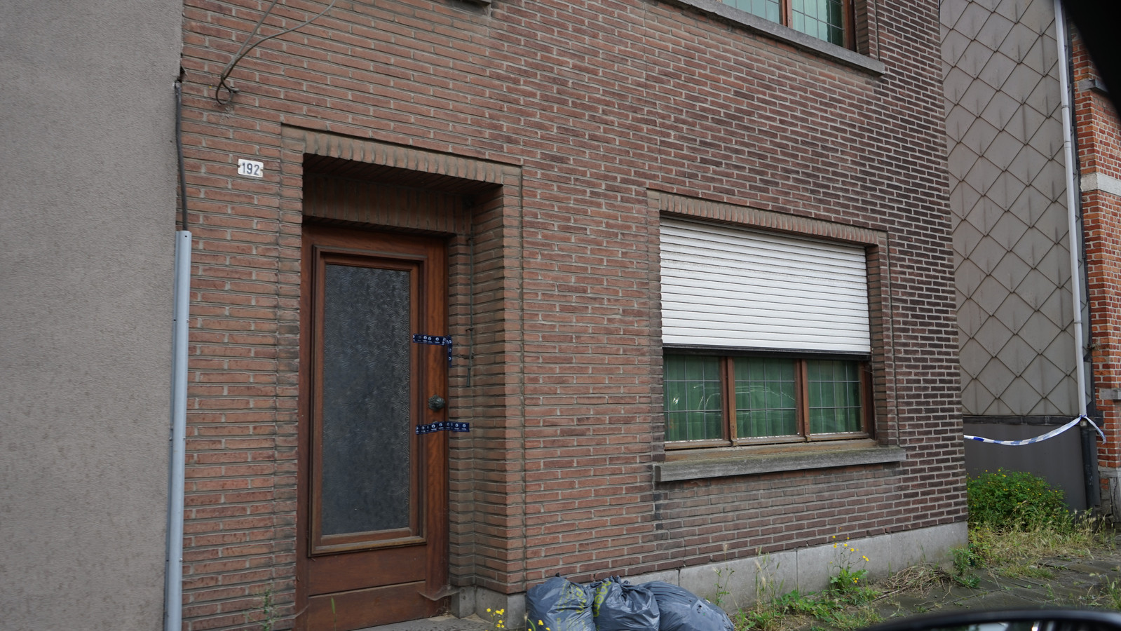Het huis werd door de politie verzegeld.