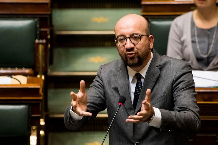 Premier Michel en zijn vicepremiers bereikten gisteravond een akkoord over de losse eindjes uit het Zomerakkoord. Beeld BELGA