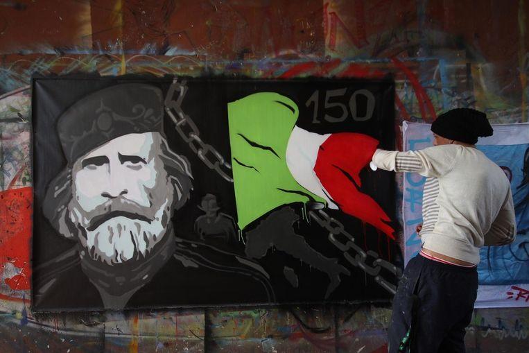 Een graffiti-tekening van de Italiaanse held Giuseppe Garibaldi. Beeld EPA