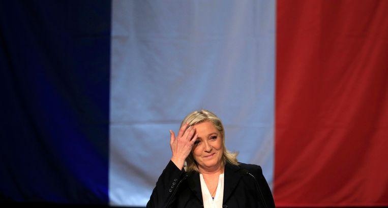 Marine Le Pen zondag na haar verkiezingsoverwinning in de eerste ronde. Beeld REUTERS