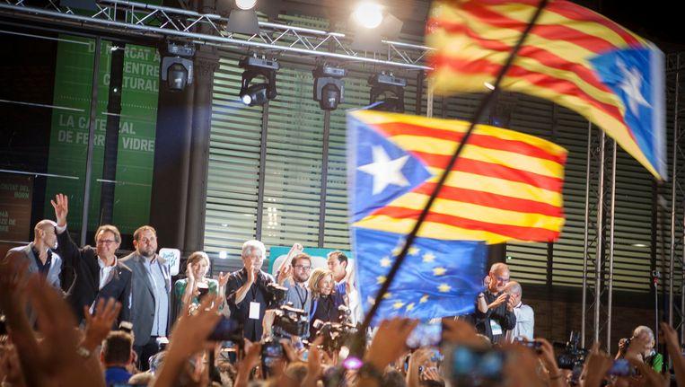 Feest was het gisteren bij de eenheidslijst Junts pel Sí, die de overwinning kon claimen. Beeld PHOTO_NEWS