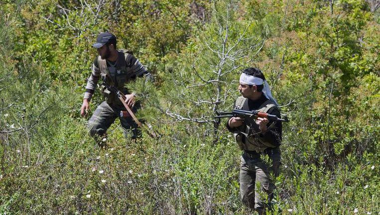 Rebellen in Latakia province in Syrië. Beeld afp