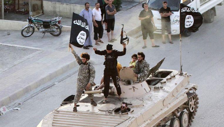 Strijders van IS in Raqqa, het bolwerk van de terreurgroep. Naar schatting 300 Chinese moslims zouden zich aangesloten hebben bij IS. (Illustratiefoto)