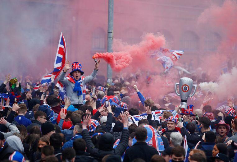 Fans van Rangers vieren het kampioenschap. Beeld Reuters