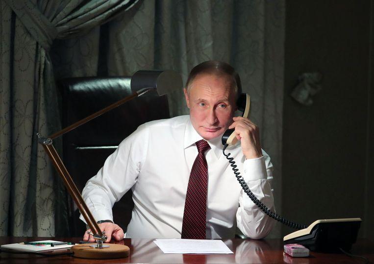Volgens het rapport geven Poetin en de hoogste Russische functionarissen 'waarschijnlijk' leiding aan beïnvloedingsoperaties. Beeld AFP