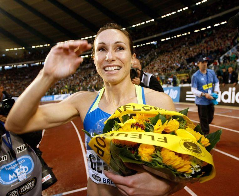 Kim Gevaert wint de 100m bij haar afscheid in 2008. Beeld Photo News