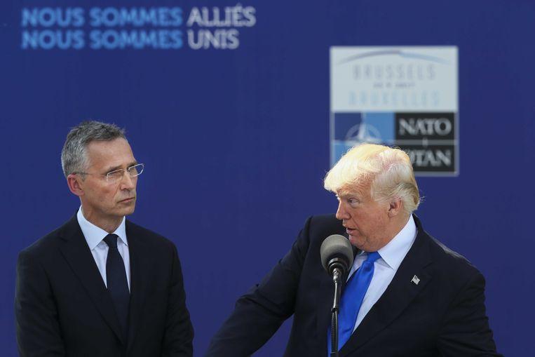 NAVO-secretaris-generaal Jens Stoltenberg en de Amerikaanse president Donald Trump  Beeld ANP