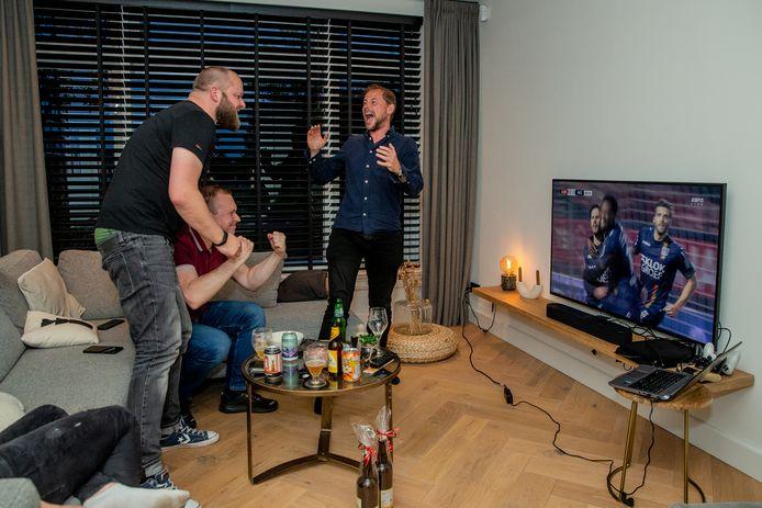 Patrick van den Berg, Wesley Eijlander en Rien Ramerman (v.l.n.r) juichen nadat Jordy Bruijn NEC op 0-2 heeft gezet tegen Almere City.