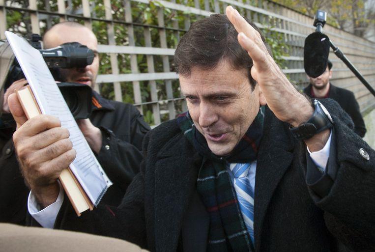 Eufemiano Fuentes arriveert bij de rechtbank. Beeld AFP