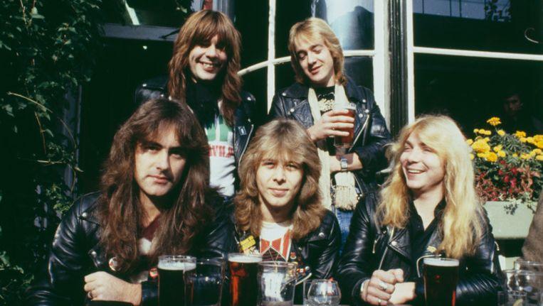 Clive Burr (midden) met de overige bandleden in 1982. Beeld GETTY