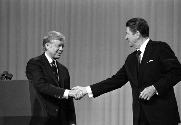 Jimmy Carter en Ronald Reagan. Beeld AP