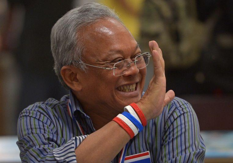 Protestleider Suthep Thaugsuban heeft zijn aanhangers opgeroepen maandag massaal te gaan. Beeld afp