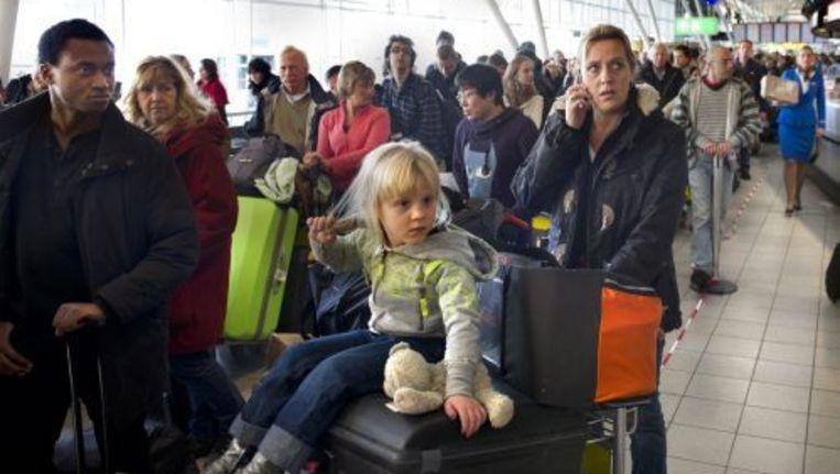 Wachtende reizigers op Schiphol. ANP Beeld