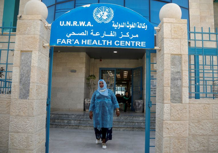 A Palestinian woman leaves a UNRWA health center in the al-Fari'ah refugee camp in the West Bank.  Image REUTERS