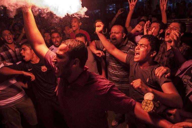 Leden van de Moslim Broederschap en aanhangers van de afgezette president Morsi betoogden eergisteren in Caïro. Beeld AFP
