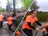Zo ploeteren de deelnemers van Broekstacle Run door de modder