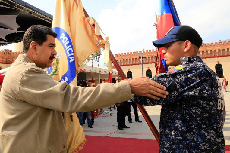 President Maduro dinsdag tijdens een militaire ceremonie in Caracas.  Beeld AFP