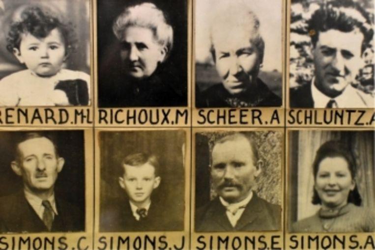 In de bibliotheek van Houffalize prijken bijna alle pasfoto's van de omgekomen inwoners. 27 dodelijke slachtoffers waren nog geen 15 jaar. Beeld