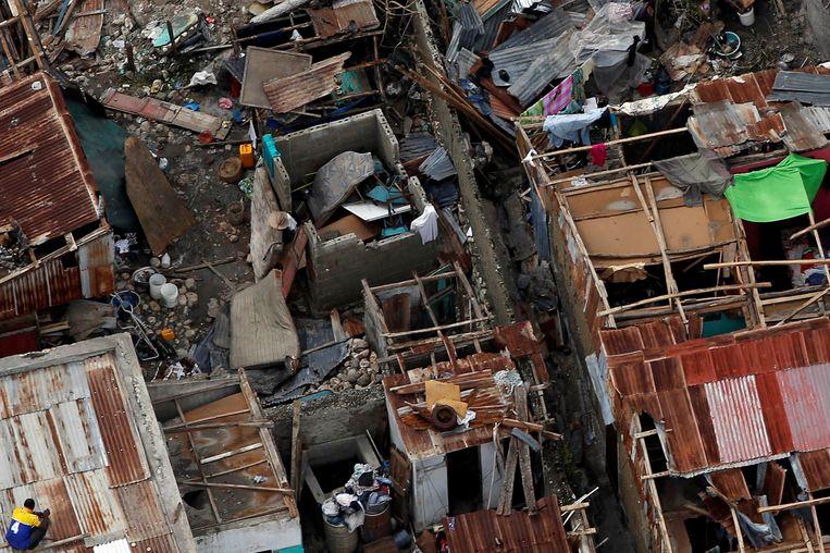 Verwoeste huizen in Haïti. Beeld REUTERS